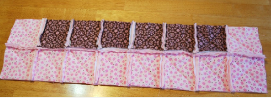 baby raggy quilt blocks sewn in rows