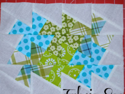 sew the lil twister blocks together to form pinwheels