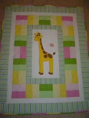 giraffe quilt that brings sunshine into a babies room