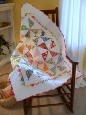 lap quilt pattern uses one charm pack