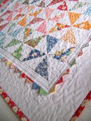one charm pack pinwheel lap quilt