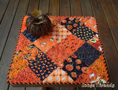 halloween-jack-o-lantern-quilted-table-topper-with-charm-square