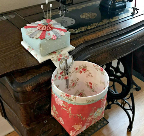 Thread catcher with weighted pin cushion