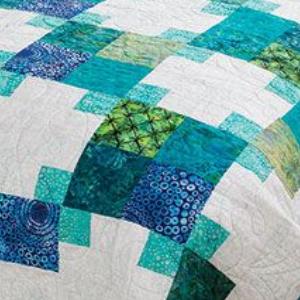 close-up-grandmas-victory-quilt-block-in-batik-blue-and-green