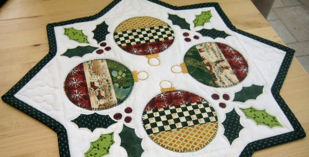 holly table topper with Christmas ornaments