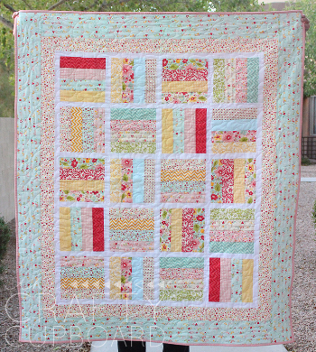 Jelly roll baby quilt in soft pastel colors