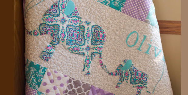 Baby elephant following its mother baby quilt a charming scene