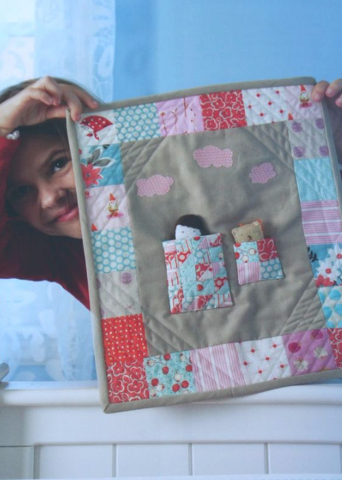 Pretty in Patchwork doll quilt made with mini charms