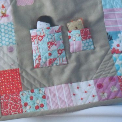 miniature quilts on a doll quilt from Pretty In patchwork