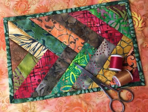 Boundless Batiks Tropics braided mug rug