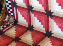 Eleanor Burns Log Cabin quilt with stars in the sashing