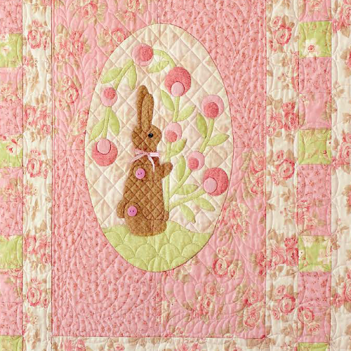 bunny wall quilt with appliqued flowers