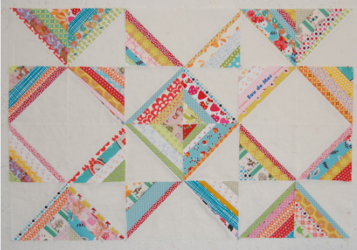 string quilt blocks with floral prints