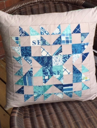 decorative pillow made with mini charm squares