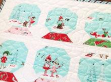 Pixie Noel fabric snowglobe mini quilt