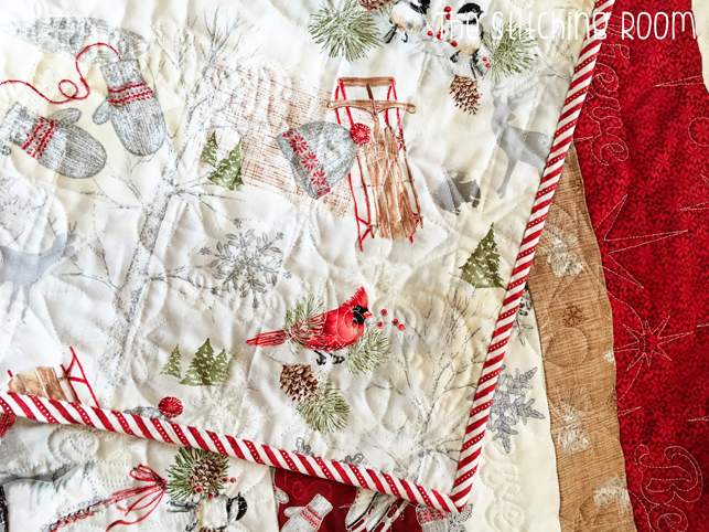 strip quilt pattern with Red rooster fabric Winter Celebration