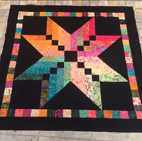 A Jelly Roll Star Quilt Using Just One Binding Tool