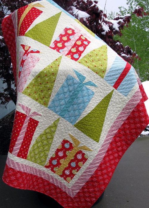 Hip Holiday Christmas Quilt With Decorated Trees And Gift