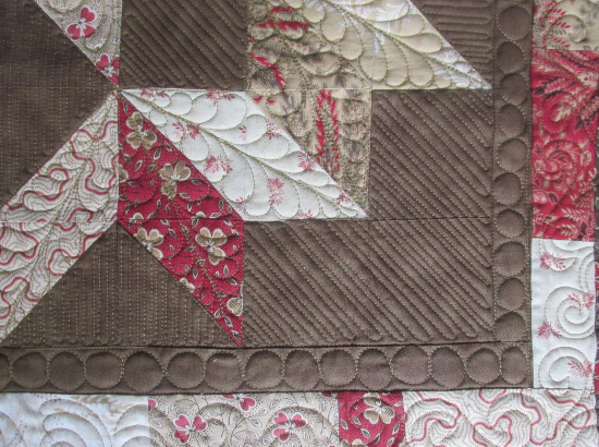 quilting feathers on a Bali Sky Carpenters Star