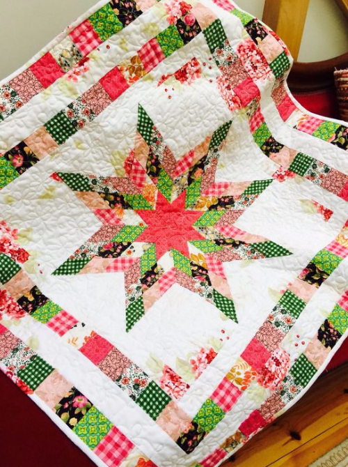 Girl baby quilt in bright quilt fabric
