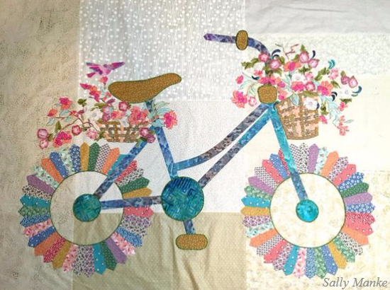 Bicycle quilt with basket of flowers