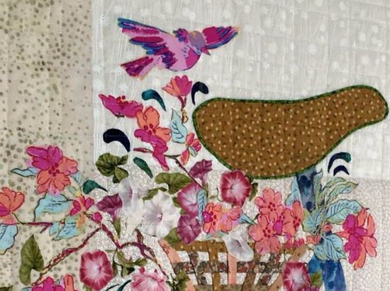 basket of flowers with bird bicycle quilt