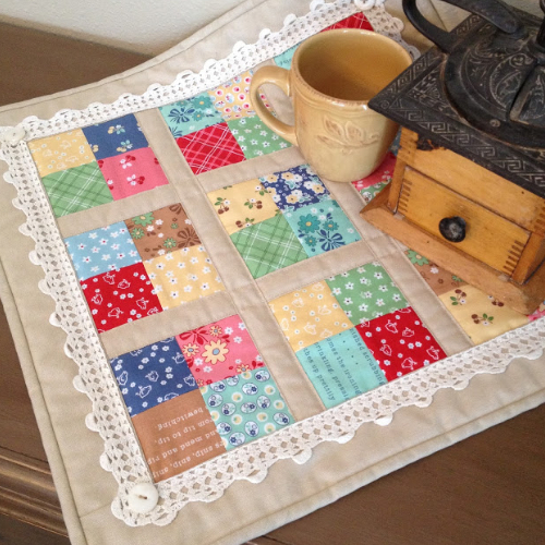 four patch table topper with crochet