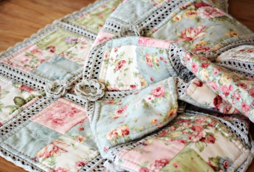 patchwork quilt with crochet roses