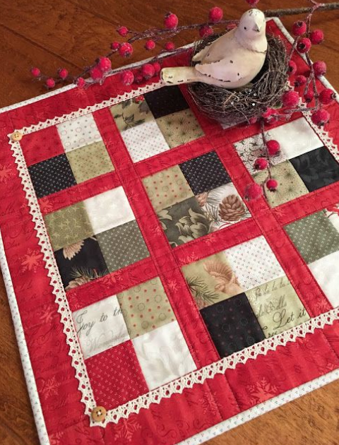 quilted table topper with crochet trim