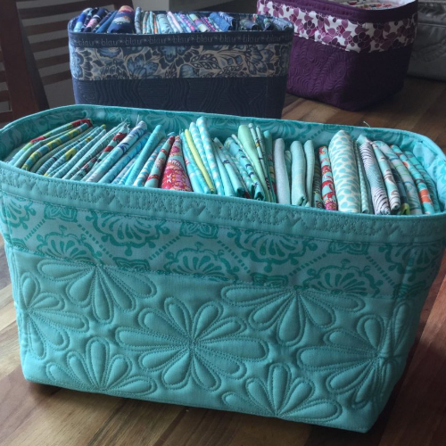 fabric baskets with embroidered edge