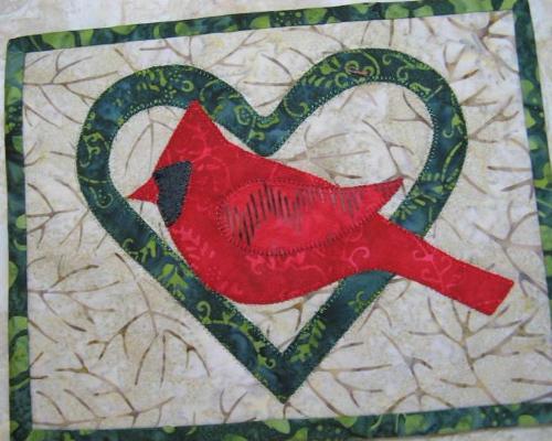 Cardinal mug rug in heart