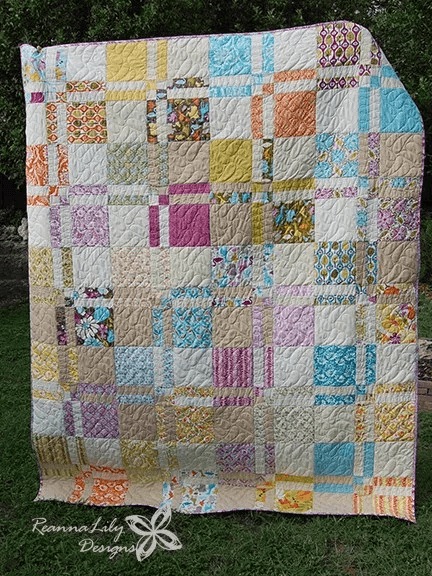 Layer Cakes Make A Delicious Disappearing Four Patch Quilt